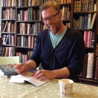 Slightly Foxed Autumn Bookshop of the Quarter: Much Ado Books. Author Damian Barr signing books in the barn.